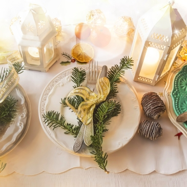 place settings on a table with holiday decor
