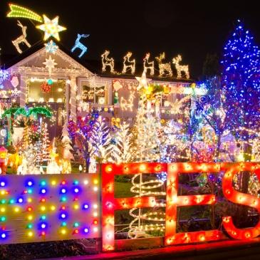 House with abundant holiday lights and decorations