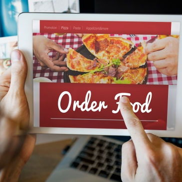 person ordering food online from tablet